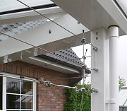 Wire trellis system on winter garden
