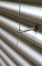 Wire trellis system on aluminum corrugated profile