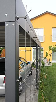 Wire trellis system on carport