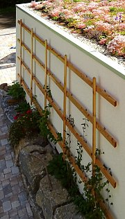 Wooden trellis on a prefab garage, installed with AS 10100