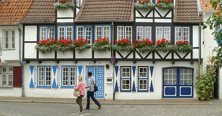 Timber frame construction with flower boxes in Schleswig-Holstein