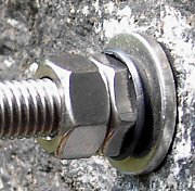 Rawl plug mounted, plug expansion indicator fully compressed, indicating that the plug is in place.